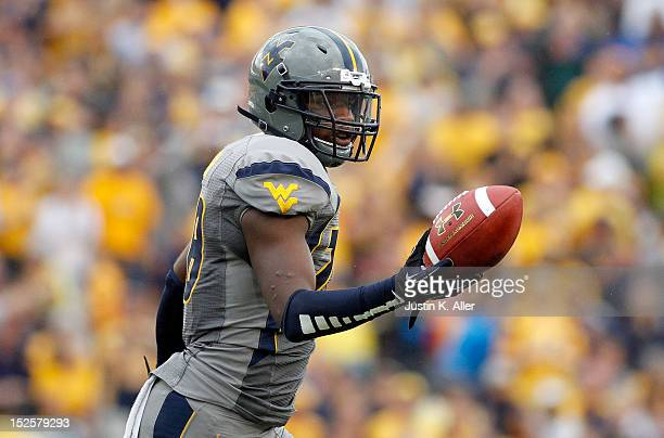 Terence Garvin of the West Virginia Mountaineers celebrates after recovering a fumble in the fourth quarter against the Maryland Terrapins during the...