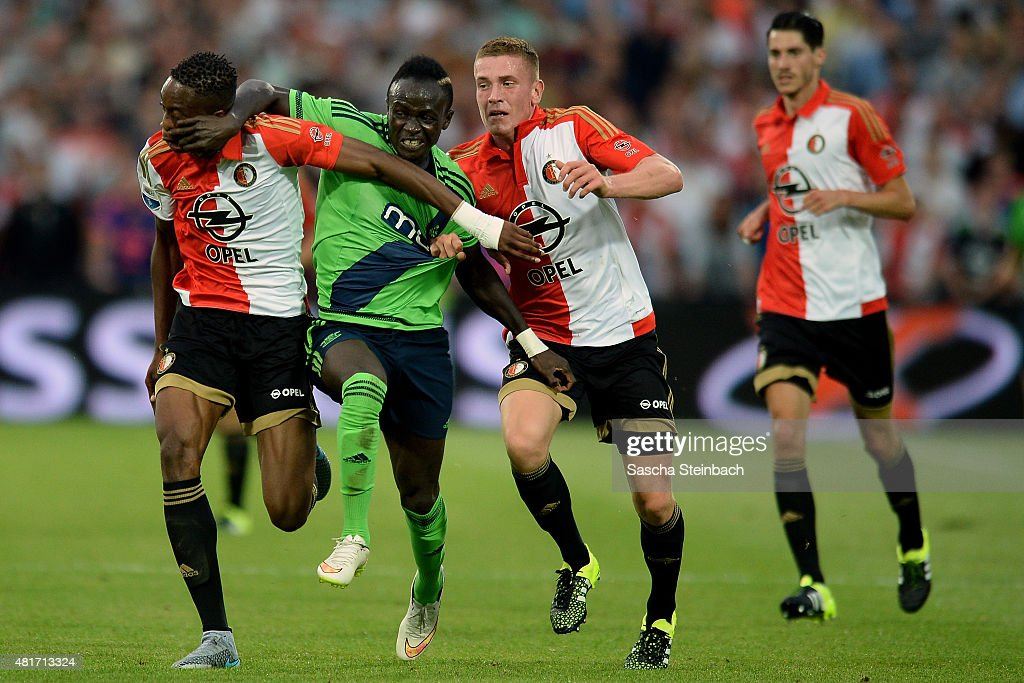 Terence Kongolo (L) and Wessel Dammers (R) of Feyenoord battle for the ball with Sadio Mane (C) of Southampton during the pre season friendly match between Feyenoord Rotterdam and Southampton FC at De Kuip on July 23, 2015 in Rotterdam, Netherlands.