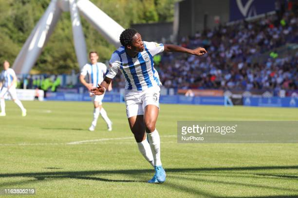 Terence Kongolo ducks to head the ball during the Sky Bet Championship match between Huddersfield Town and Reading at the John Smith's Stadium,...