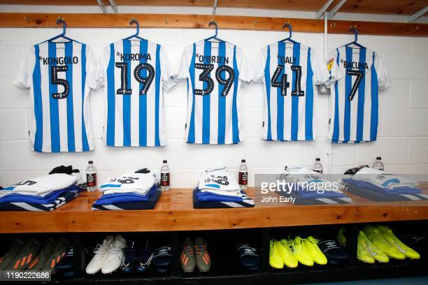 Terence Kongolo, Josh Koroma, Lewis O'Brien, Matty Daly and Juninho Bacuna of Huddersfield Town's shirts before the Sky Bet Championship match...