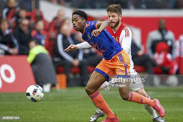 Terence Kongolo of Feyenoord Lasse Schone of Ajax during the Dutch Eredivisie match between Ajax Amsterdam and Feyenoord Rotterdam at the Amsterdam...
