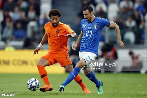 Terence Kongolo of Holland Davide Zappacosta of Italy during the International friendly match between Italy and The Netherlands at Allianz Stadium on...