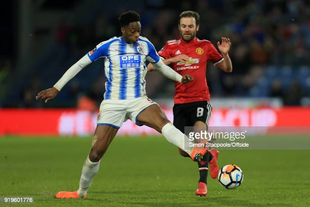 Terence Kongolo of Huddersfield battles with Juan Mata of Man Utd during The Emirates FA Cup Fifth Round match between Huddersfield Town and...