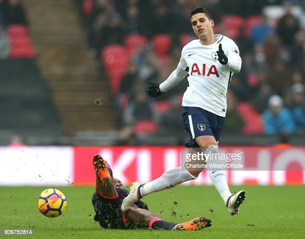 Terence Kongolo of Huddersfield tackles Erik Lamela of Tottenham during the Premier League match between Tottenham Hotspur and Huddersfield Town at...