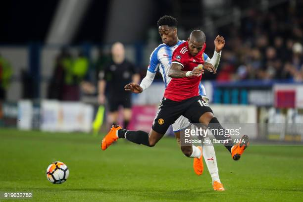 Terence Kongolo of Huddersfield Town and Ashley Young of Manchester United during the Emirates FA Cup Fifth Round match at The John Smiths Stadium on...