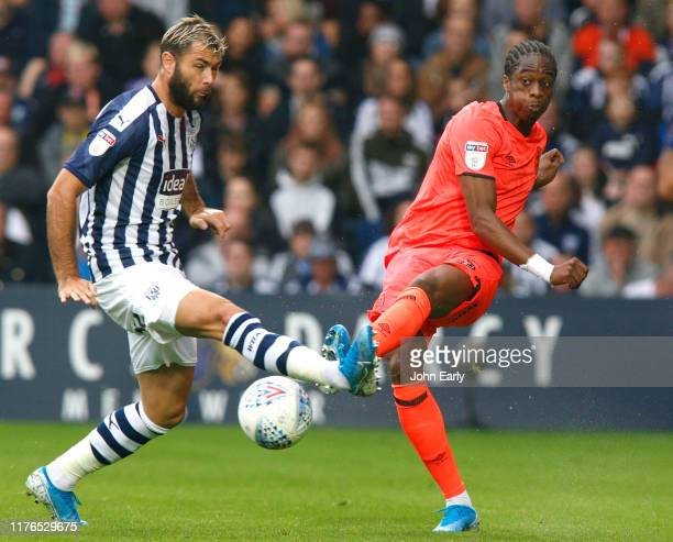 Terence Kongolo of Huddersfield Town and Charlie Austin of West Bromwich Albion during the Sky Bet Championship match between West Bromwich Albion...