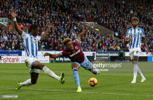 Terence Kongolo of Huddersfield Town and Grady Diangana of West Ham United stretch for the ball during the Premier League match between Huddersfield...
