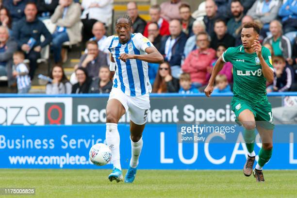 Terence Kongolo of Huddersfield Town and Jacob Murphy of Sheffield Wednesday during the Sky Bet Championship match between Huddersfield Town and...