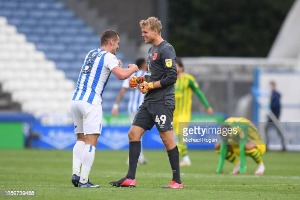 Terence Kongolo of Huddersfield Town and Jonas Loessl of Huddersfield Town celebrate following their sides victory in the Sky Bet Championship match...