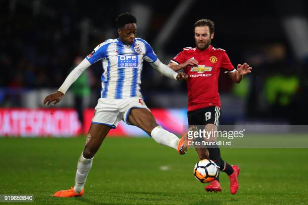 Terence Kongolo of Huddersfield Town and Juan Mata of Manchester United in action during the Emirates FA Cup Fifth Round match between Huddersfield...