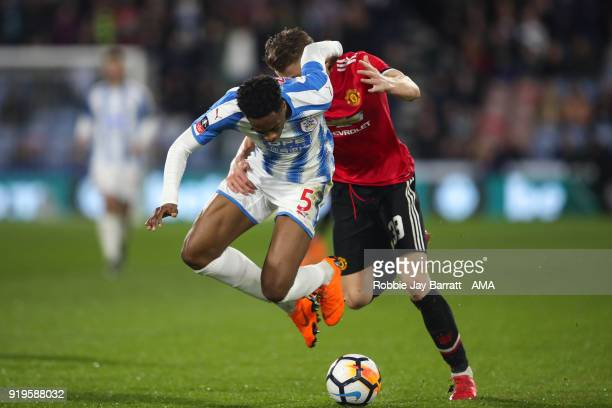 Terence Kongolo of Huddersfield Town and Scott McTominay of Manchester United during the Emirates FA Cup Fifth Round match at The John Smiths Stadium...