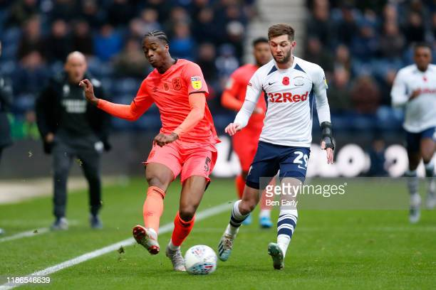 Terence Kongolo of Huddersfield Town and Tom Barkhuizen of Preston North End during the Sky Bet Championship match between Preston North End and...