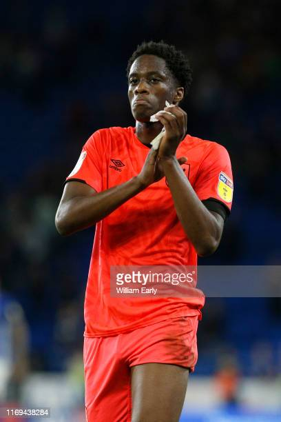 Terence Kongolo of Huddersfield Town applauds the fans during the Sky Bet Championship match between Cardiff City and Huddersfield Town at Cardiff...