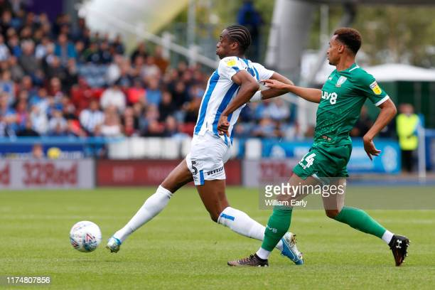 Terence Kongolo of Huddersfield Town battles with Jacob Murphy of Sheffield Wednesday during the Sky Bet Championship match between Huddersfield Town...