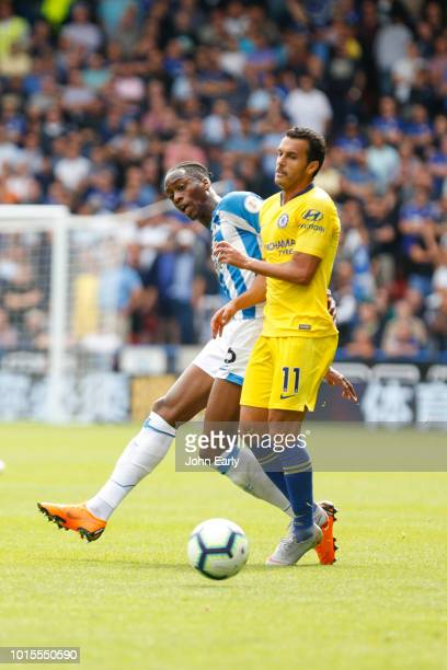 Terence Kongolo of Huddersfield Town beats Pedro of Chelsea during the Premier League match between Huddersfield Town and Chelsea FC at John Smith's...