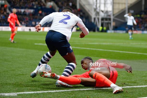 Terence Kongolo of Huddersfield Town challenges Darnell Fisher of Preston North End during the Sky Bet Championship match between Preston North End...