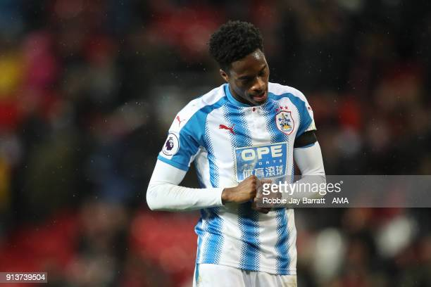 Terence Kongolo of Huddersfield Town dejected at full time during the Premier League match between Manchester United and Huddersfield Town at Old...