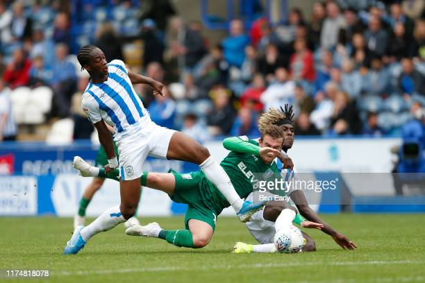 Terence Kongolo of Huddersfield Town fouls Sam Winnall of Sheffield Wednesday during the Sky Bet Championship match between Huddersfield Town and...