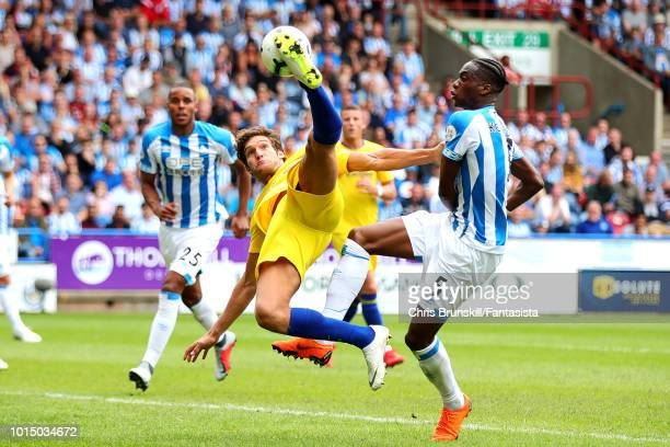 Terence Kongolo of Huddersfield Town in action with Marcos Alonso of Chelsea during the Premier League match between Huddersfield Town and Chelsea FC...