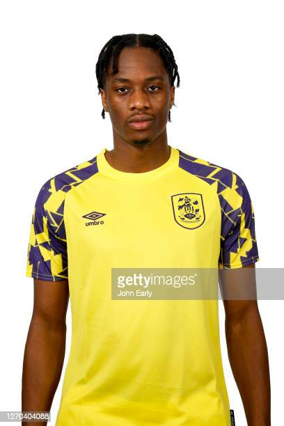 Terence Kongolo of Huddersfield Town in the second alternate kit for the 2020/21 season on August 31, 2020 in Huddersfield, England.