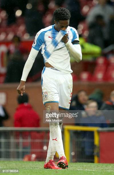 Terence Kongolo of Huddersfield Town leaves the pitch dejected following the Premier League match between Manchester United and Huddersfield Town at...