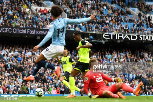 Terence Kongolo of Huddersfield Town scores an own goal for Manchester City's sixth goal during the Premier League match between Manchester City and...