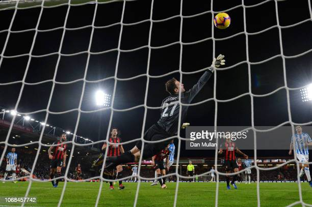 Terence Kongolo of Huddersfield Town scores his team's first goal past Asmir Begovic of AFC Bournemouth during the Premier League match between AFC...
