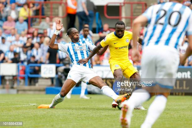 Terence Kongolo of Huddersfield Town tackles Victor Moses of Chelsea during the Premier League match between Huddersfield Town and Chelsea FC at John...