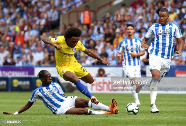 Terence Kongolo of Huddersfield Town tackles Willian of Chelsea during the Premier League match between Huddersfield Town and Chelsea FC at John...