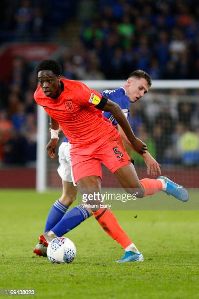 Terence Kongolo of Huddersfield Town takes on Gavin Whyte of Cardiff City during the Sky Bet Championship match between Cardiff City and Huddersfield...