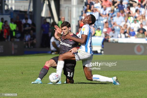 Terence Kongolo tackles Lucas Boye during the Sky Bet Championship match between Huddersfield Town and Reading at the John Smith's Stadium,...