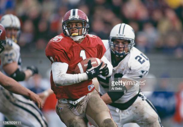Terence Patterson, Wide Receiver of the Harvard University Crimson runs the football away from Andy Tuzzolino, Defensive Lineman for the Yale...