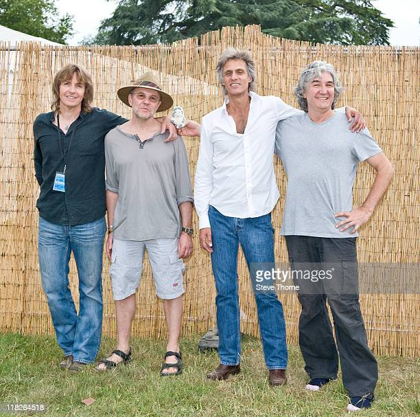Terence Reis Alan Clark Chris White and Phil Palmer of The Straits pose backstage during the third day of Cornbury Festival on July 3 2011 in Oxford...