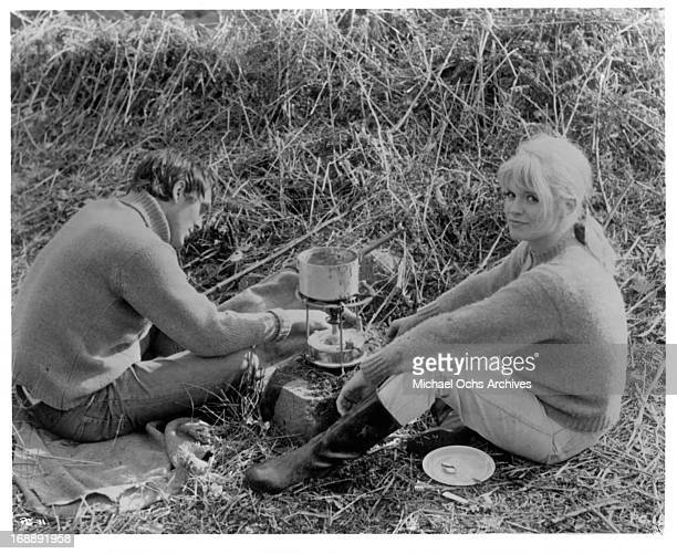 Terence Stamp has a picnic with Carol White in a scene from the film 'Poor Cow' 1967
