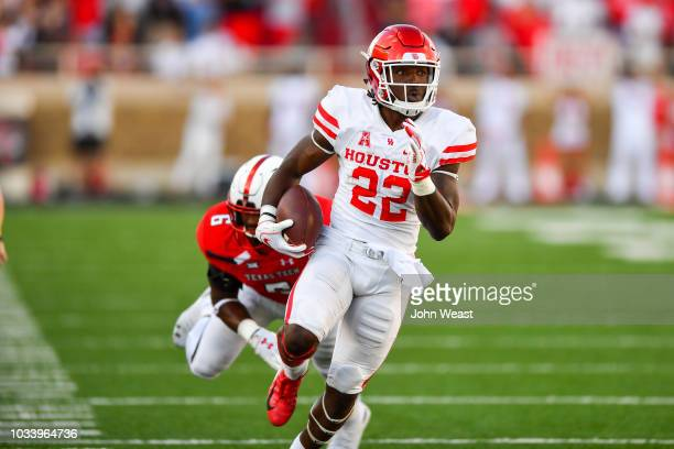 Terence Williams of the Houston Cougars breaks the tackle of Riko Jeffers of the Texas Tech Red Raiders in the second half during the game on...