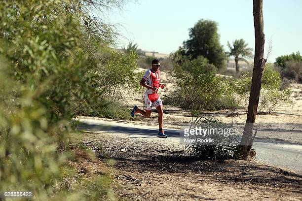Terenzo Bozzone of New Zealand competes in the run section of Ironman 703 Middle East Championship Bahrain on December 10 2016 in Bahrain Bahrain