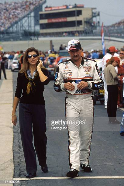 Teresa and Dale Earnhardt walk along pit road prior to a NASCAR Cup race at Dover Downs International Speedway
