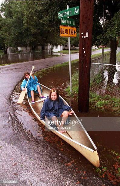 Teresa Bell 14yearsold and her buddy Amber Berger 13yearsold navigate a turn in the road as they paddle a canoe throught a drainage ditch near their...