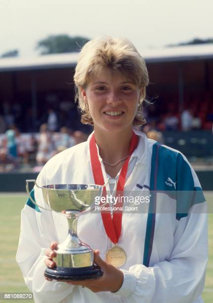 Teresa Catlin of Great Britain poses with the trophy after winning the Girls' Singles Final of The Junior Grass Court Championships of Great Britain...