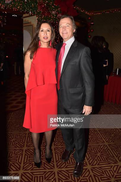Teresa Colley and Bruce Colley attend A Christmas Cheer Holiday Party 2017 Hosted by George Farias Anne and Jay McInerney at The Doubles Club on...
