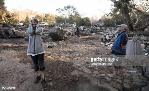 Teresa Drenick left stands among belongings of her sister Rebecca Riskin was killed in the mudslide along San Ysidro Creek on January 11 2018 in...