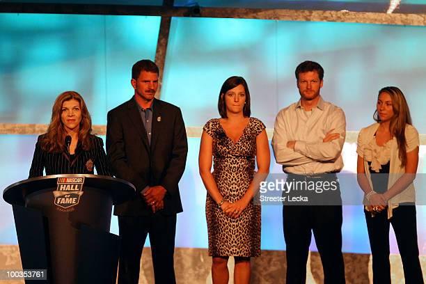Teresa Earnhardt speaks as Kerry Earnhardt Kelley Earnhardt Elledge Dale Earnhardt Jr and Taylor Earnhardt stand on stage as Dale Earnhardt Sr gets...