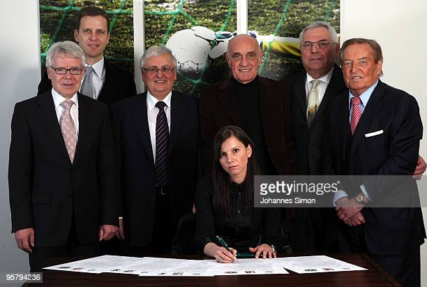Teresa Enke , widow of goalkeeper Robert Enke signs the charter of the Robert Enke Foundation in presence of DFB officials Reinhard Rauball, Oliver...