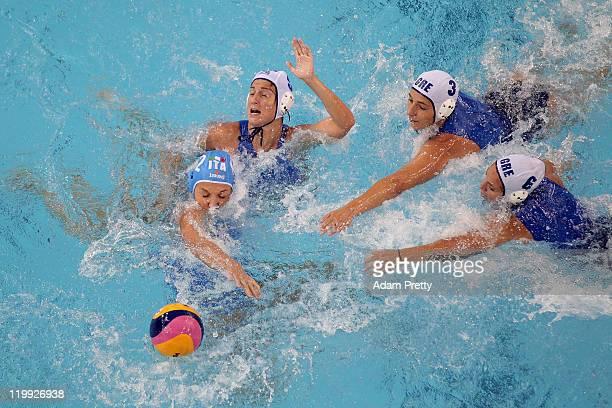 Teresa Frassinetti of Italy is challenged by Kyriaki Liosi Antiopi Melidoni and Alkisti Avramidou of Greece in the Women's Water Polo semi final...