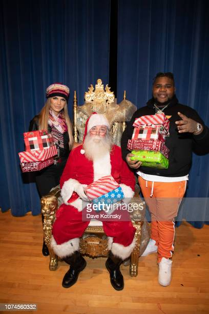 Teresa Giudice and Fat Boy SSE attends the Cesar DJ Envy's 2018 Holiday Toy Giveaway on December 21 2018 in Paterson New Jersey