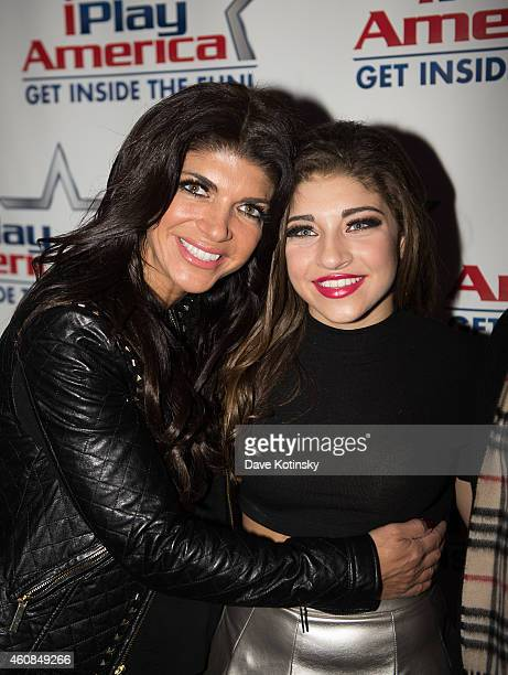 Teresa Giudice and Gia Giudice pose at iPlay America on December 26 2014 in Freehold New Jersey