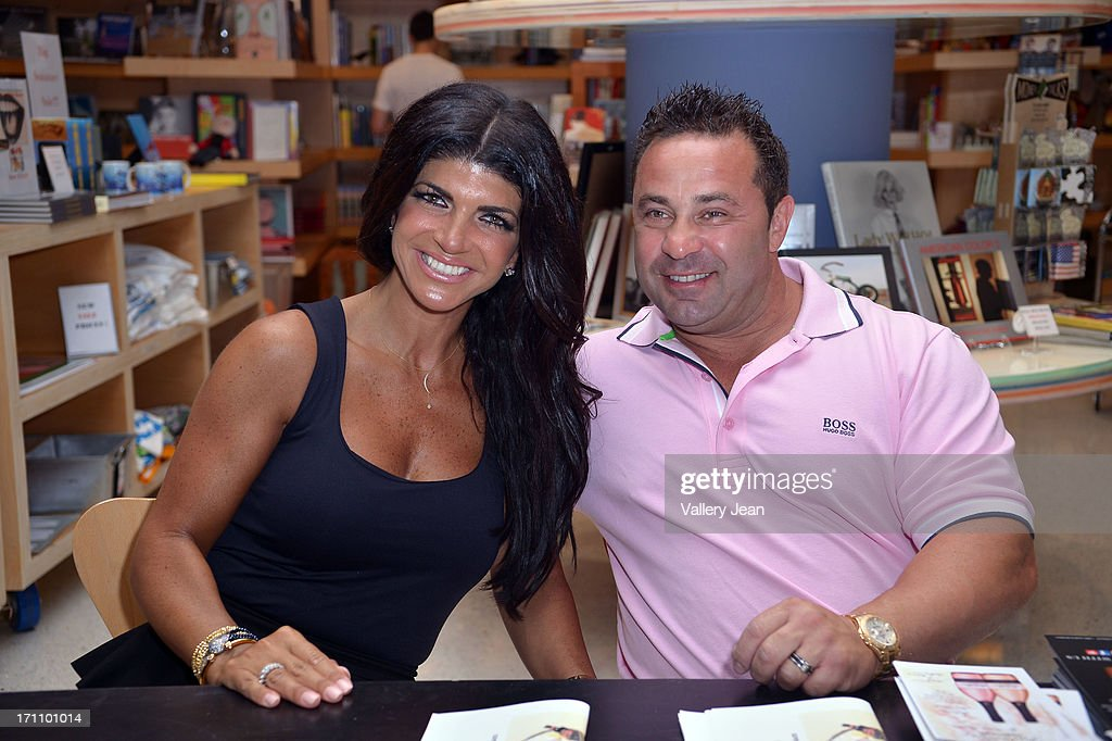 Teresa Giudice and her husband Joe Giudice greets fans and signs copies of 'Fabulicious On The Grill' at Books and Books at Museum of Art on June 21, 2013 in Fort Lauderdale, Florida.