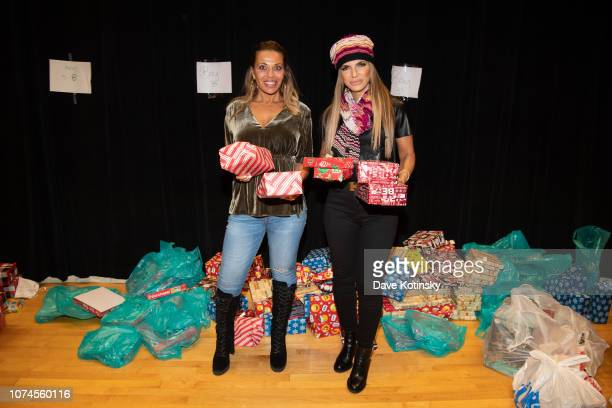 Teresa Giudice and RHONJ Dolores Catania attend the Cesar DJ Envy's 2018 Holiday Toy Giveaway on December 21 2018 in Paterson New Jersey