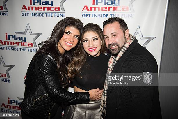 Teresa Giudice, Gia Giudice and Joe Giudice pose at iPlay America on December 26, 2014 in Freehold, New Jersey.