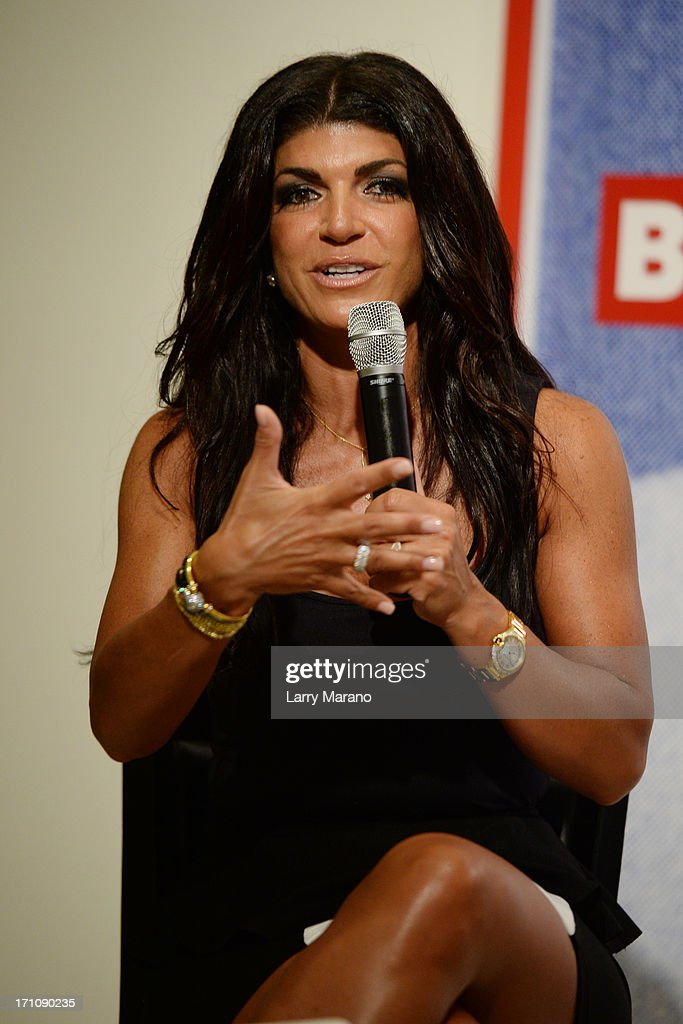 Teresa Giudice greets fans and signs copies of her book 'Fabulicious!: On The Grill: Teresa's Smoking Hot Backyard Recipes' at Books and Books at Museum of Art on June 21, 2013 in Fort Lauderdale, Florida.